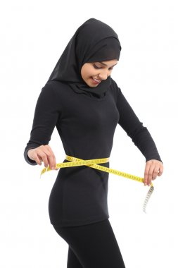 Arab woman measuring waist with a measure tape
