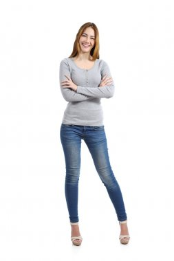 Confident full body of a casual happy woman standing wearing jeans
