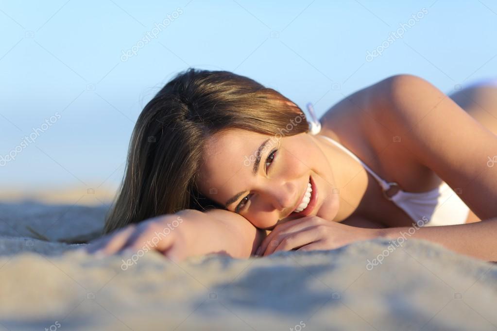 Portrait of a Beautiful woman sunbathing lying on the beach