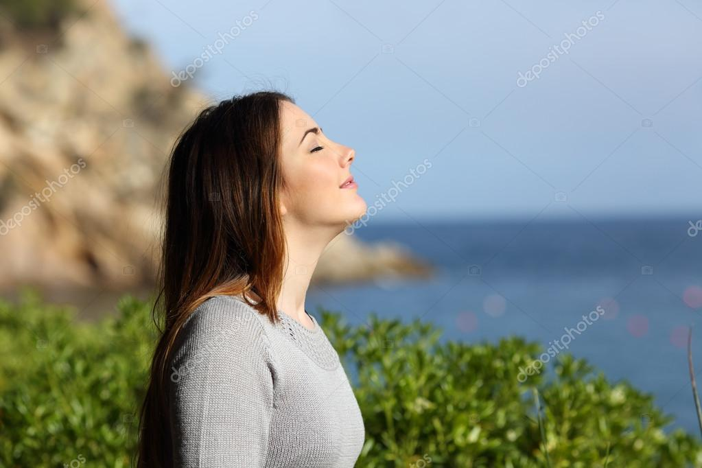 Woman breathing fresh air relaxed on vacation