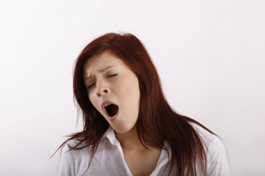 Woman making a big yawn
