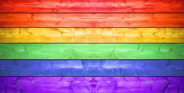 Wooden fence with rainbow colors