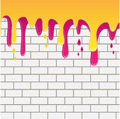 giallo e lilla dipingere che scorre verso il basso su un muro di mattoni bianchi