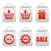 set of paper shopping bags with red emblems for online shop