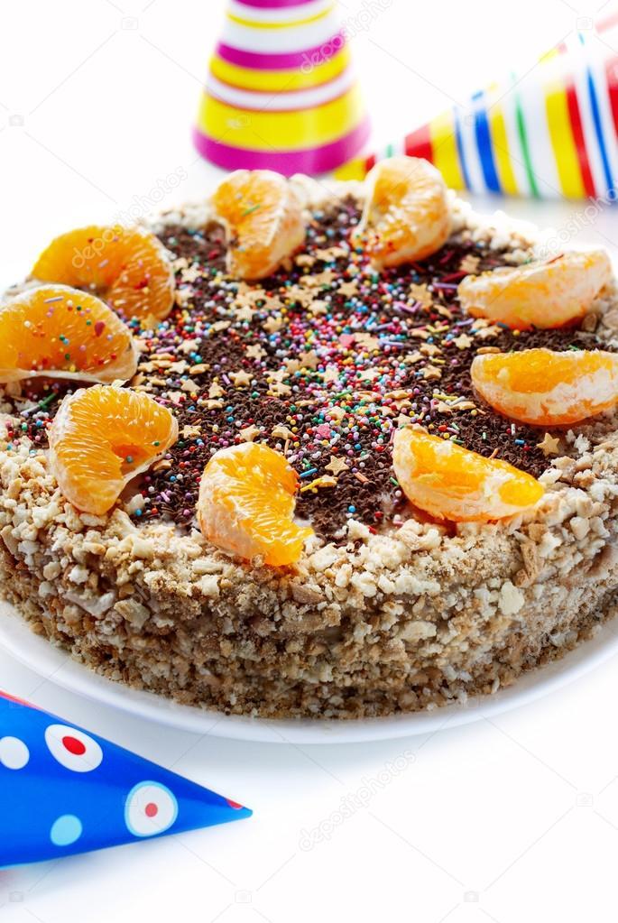 Kuchen Verziert Mit Segmenten Aus Orangen Und Schokostreusel