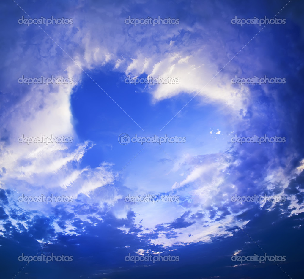 clouds in the shape of heart on blue sky — stock photo © olgapink