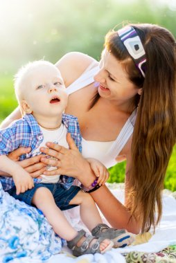 Happy Mother playing with her son, who has Cerebral palsy