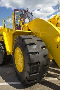 yellow road building powerful wheeler