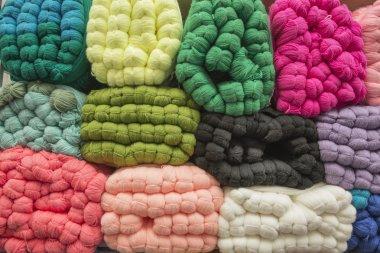 sale of colored skeins of wool yarn in bales