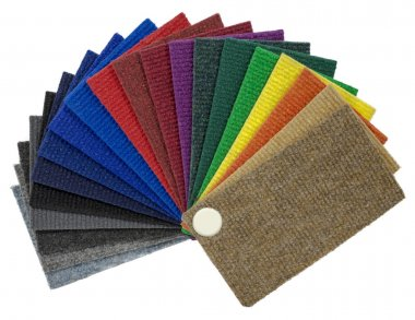 Multi-colored carpeting samples by a fan