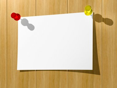 A sheet of paper for notes pinned by two buttons to a wooden wal
