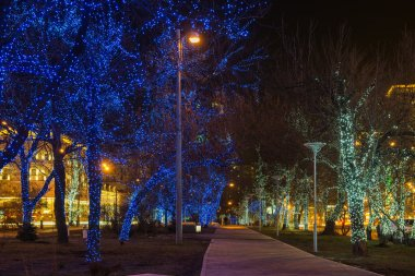 luminous garlands on the trees in the streets of old Moscow