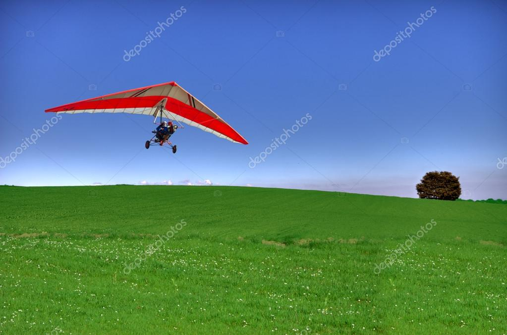 Hang glider on green