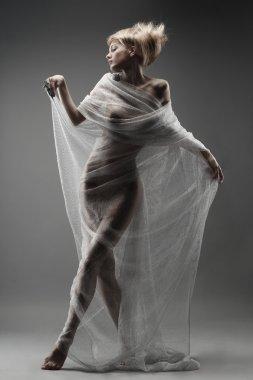beautiful pensive glamourous girl in fishnet dancing