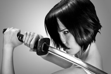 brunette with short hair holding a katana sword