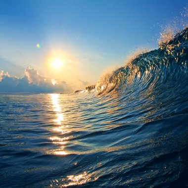 sunset on the beach with screw ocean wave