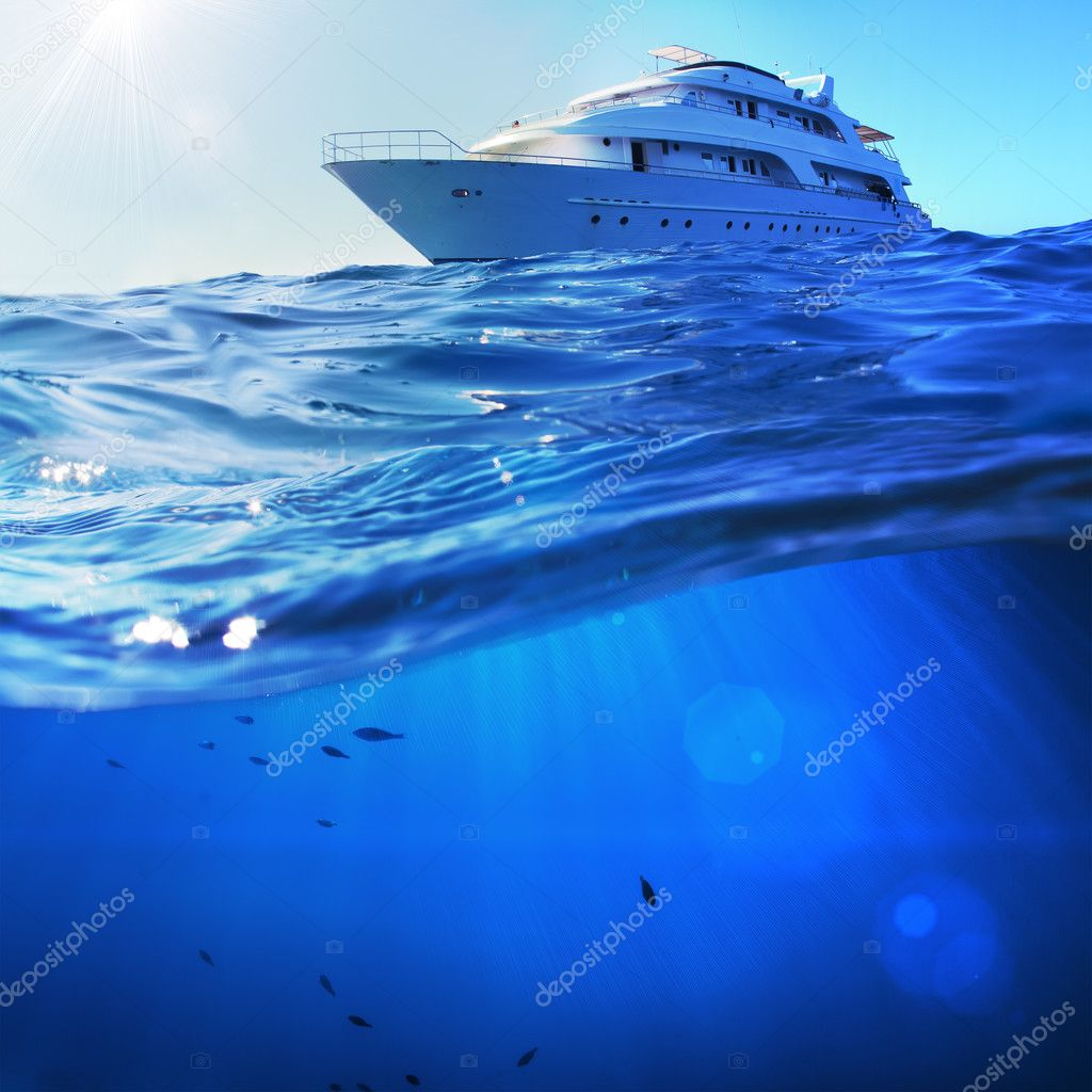 Фотообои beautiful sunlight seaview safari dive boat in tropical sea with deep blue underneath splitted by waterline