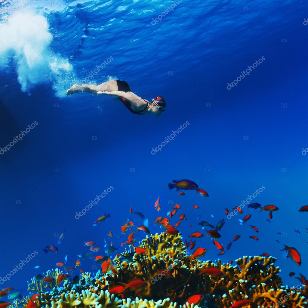 Professional freediver making apnea gliding underwater