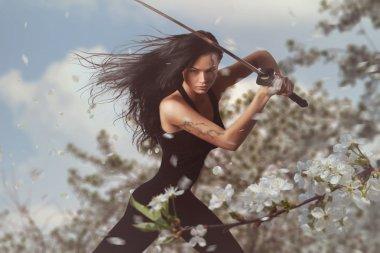 Beautiful Brunette with katana sword