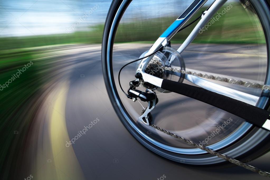 View of rear wheel with chain and cassette in motion