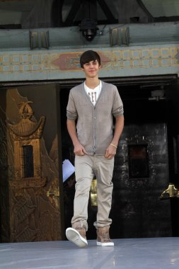 Justin Bieber at Michael Jackson Immortalized at Grauman's Chinese Theatre, Hollywood, CA 01-26-12
