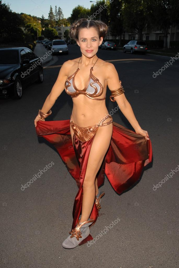 Alicia Arden one of many celebrities wearing a Princess Leia Slave Girl costume from Star Wars at the West Hollywood Halloween Celebration, Various Locations, West Hollywood, CA 10-31-09 EXCLUSIVE stock vector