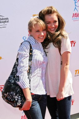 Emily Osment and Miley Cyrus at the 2007 Power of Youth Benefiting St. Jude. The Globe Theatre, Universal City, CA. 10-06-07
