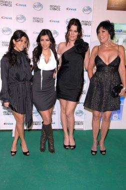 Sisters Kardashian and Kris Jenner