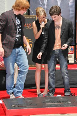 Rupert Grint with Emma Watson and Daniel Radcliffe
