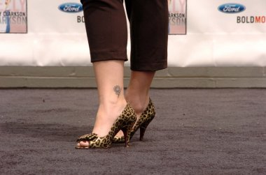 Kelly Clarksons shoes at a press conference to announce Ford new marketing campaign Bold Moves. Galpin Ford, North Hills, CA. 05-02-06