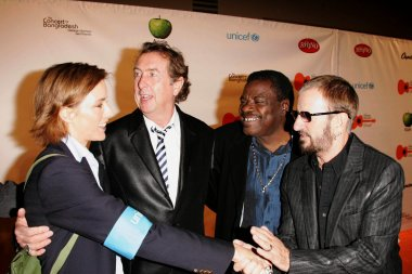Tea Leoni and Eric Idle with Billy Preston and Ringo Starr