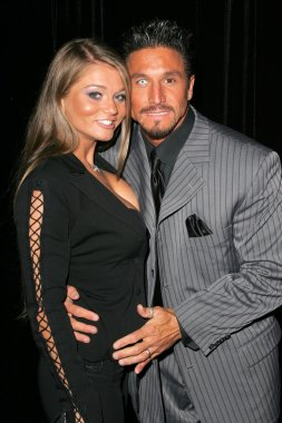 Rita Faltoyano and Tommy Gunn