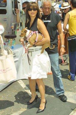 Kelly Hu and her dog Mu Shu