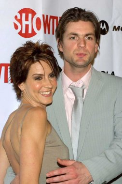 Michelle Clunie and Gale Harold