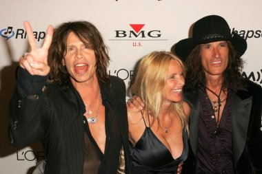 Steven Tyler with Joe Perry and his wife