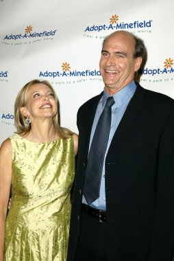 James Taylor and wife