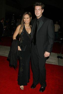 Tia Carrere and Simon Wakelin