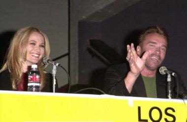 Arnold Schwarzenegger and Sarah Wynter