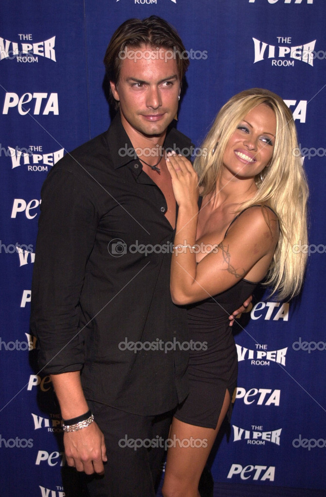 Pam anderson and marcus schenkenberg stock editorial photo pam anderson and marcus schenkenberg stock photo thecheapjerseys Gallery