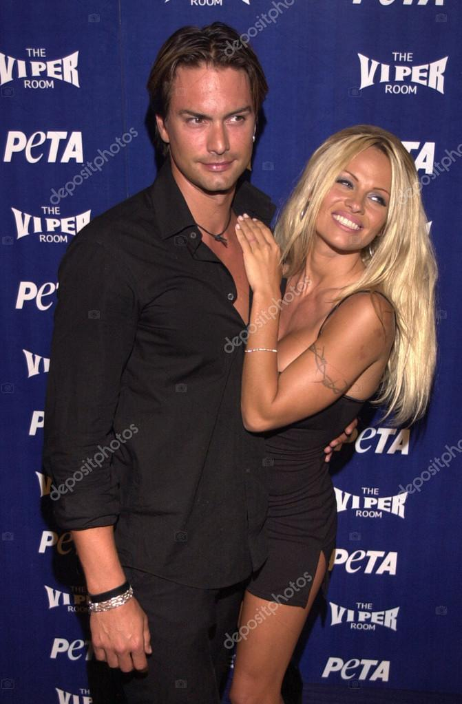 Pam anderson and marcus schenkenberg stock editorial photo pam anderson and marcus schenkenberg stock photo altavistaventures Image collections