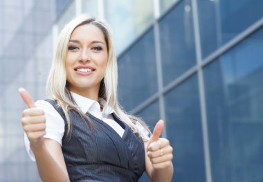Young happy business woman over modern background