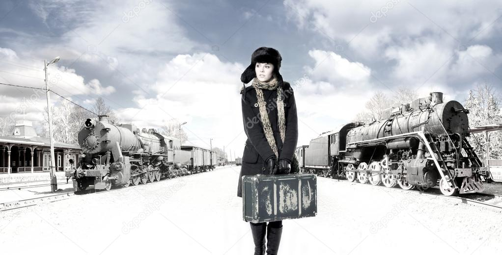 Retro photo of young and attractive woman on the train station