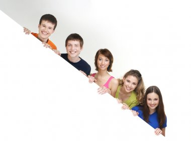Group of teenagers with a giant, blank