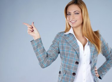 Young attractive redhead business woman
