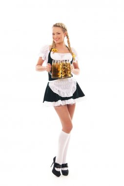 Young and beautiful bavarian girl isolated over white background