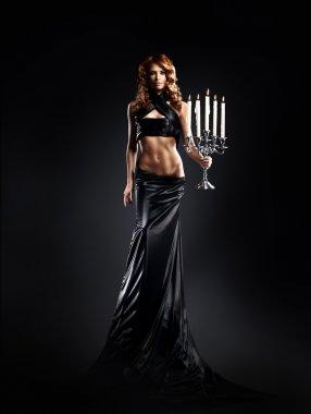 Fashion shoot of beautiful woman in a long dress