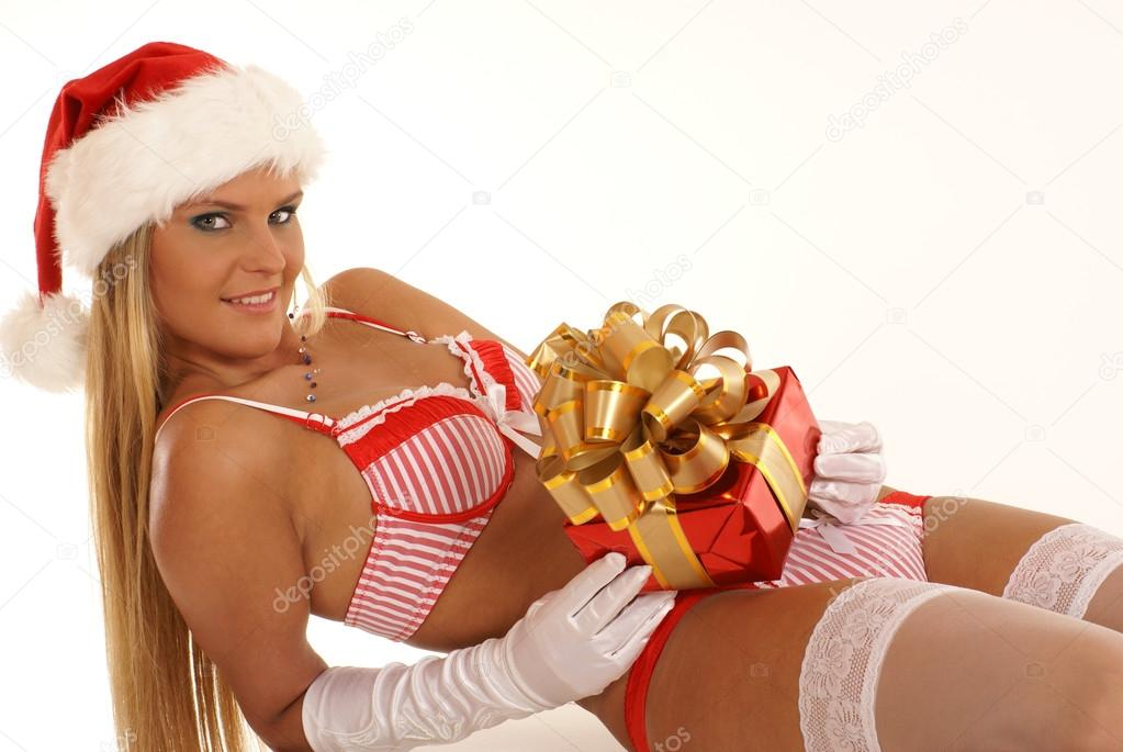 Young sexy Santa with a gift isolated on white