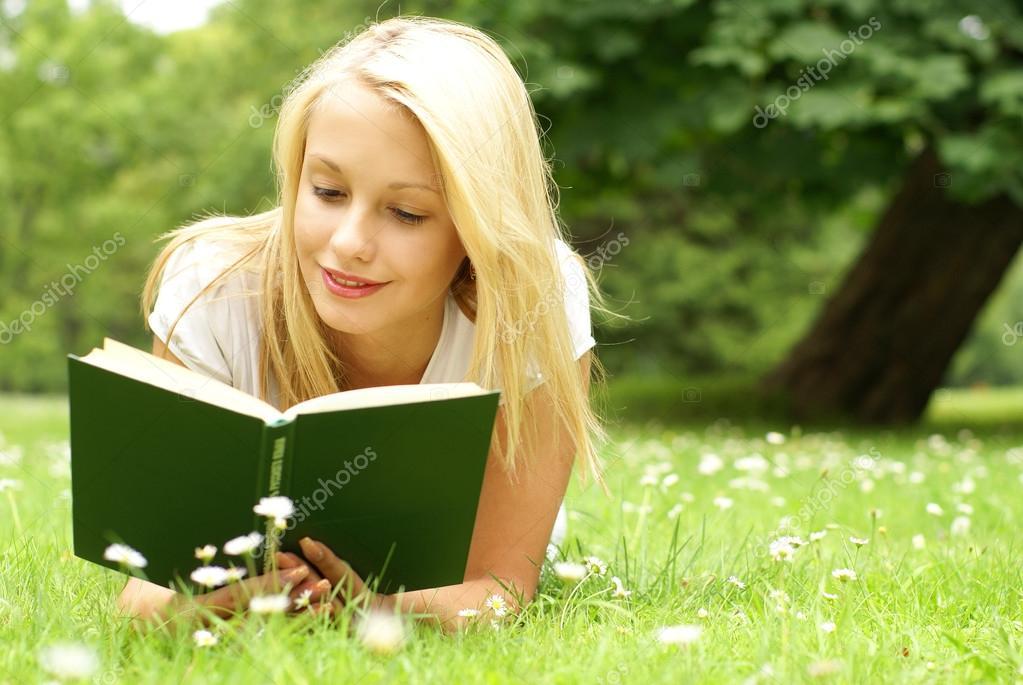 Young beautiful girl reading
