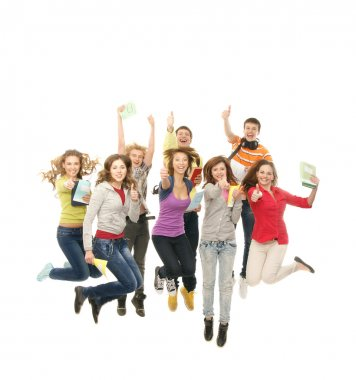 Group of smiling teenagers jumping together and looking at camera