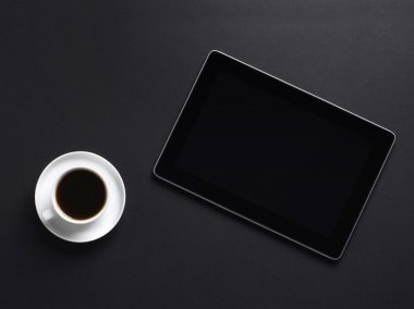 A cup of coffe and a tablet pc